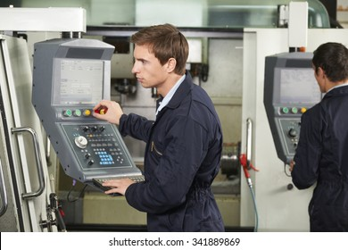 Engineer Operating Computer Controlled Cutting Machine