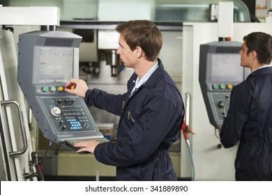 Engineer Operating Computerized Cutting Machine