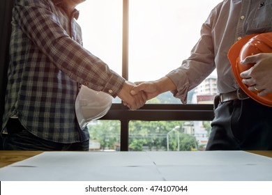 engineer people shaking hands in office, engineering concept, architecture concept, teamwork concept, soft focus, vintage tone