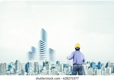 Engineer planning the future expansion of the city.