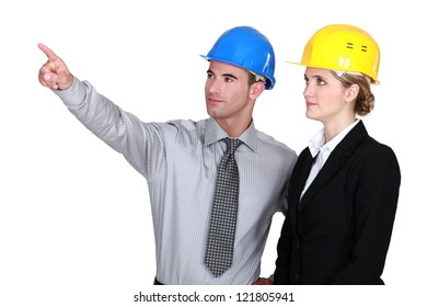 An engineer pointing out a problem to his colleague