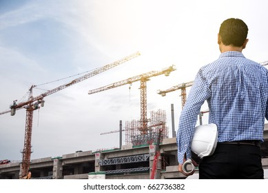 Engineer and Power Crane in the City as Construction Project concept.