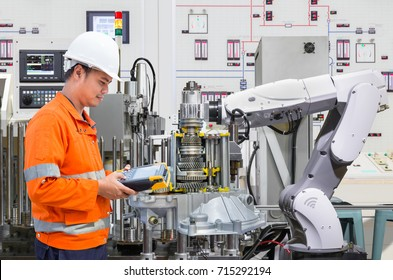 Engineer programing automated robotic industry in automotive industry