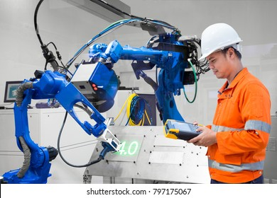 Engineer programming control laser robotic cutting on metal plate, Industry 4.0 concept