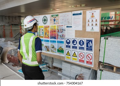 The engineer reading notice board of safety policy before working in construction site in Bangkok Thailand on 31 Oct 2017. Selective focus