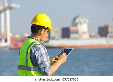 Engineer recording information of container during transportation in port