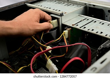 Engineer is repairing electric wire computer hardware in a computer CPU