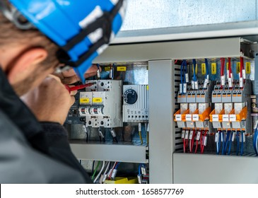 A engineer repairing electrical installation