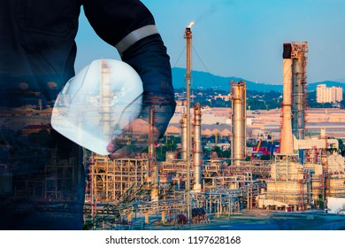 Engineer with safety helmet and oil refinery industry plant background.