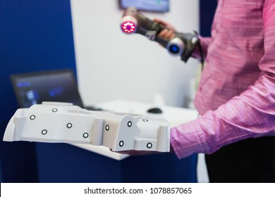Engineer scans the part with 3D scanner