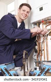 Engineer Servicing Central Heating Boiler