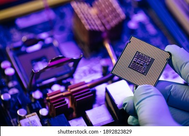 Engineer showing a computer microchip on motherboard background. Electronic circuit board with processor.