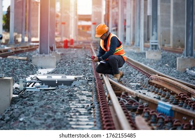 engineer sitting on railway inspection. construction worker on railways. Engineer work on railway.rail,engineer,Infrastructure
