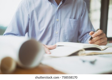 Engineer sketching architectural project on blueprint, engineering concept, architecture concept