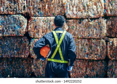 Engineer Standing and looking back The plastic bottle in the recycling industry