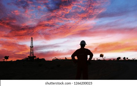 An engineer is standing in the Oilfield during sunset in the Oman