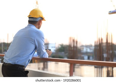 The engineer stood looking at the construction project that was beginning to take place.