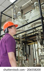 Engineer student looking part of machine in laboratory