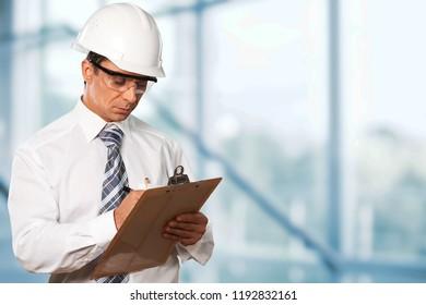 Engineer taking a note. Focused man in
