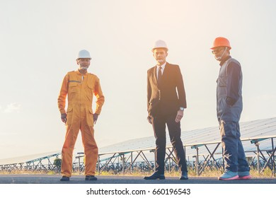 engineer team discussion and review plan for construction project solar power plant ;engineering team review and analyze information report of investment at solar power plan.