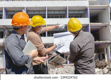 Engineer team and worker checking blueprint for emolition construction plan and inspect at the site.