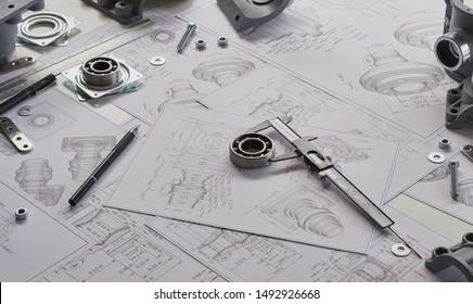Engineer technician designing drawings mechanicalparts engineering Enginemanufacturing factory Industry Industrial work project blueprints measuring bearings caliper tools