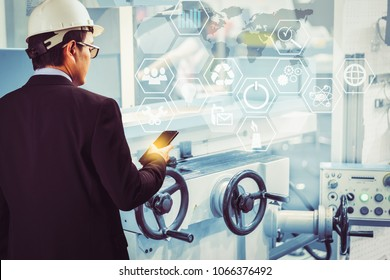 Engineer or Technician man with business industrial tool icons holding smart phone with technology