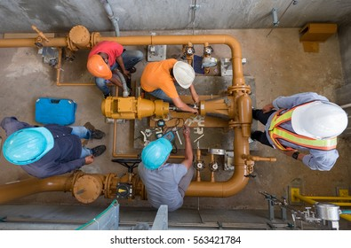 Engineer, technician and worker are alignment check of fuel oil pump in power plant