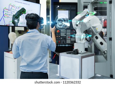 Engineer testing virtual reality glasses 3D scan with joystick control automated robot industry, Technology 4.0 concept