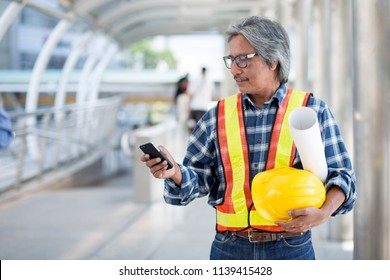 Engineer texting on mobile phone