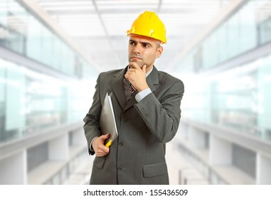engineer thinking with yellow hat at the office