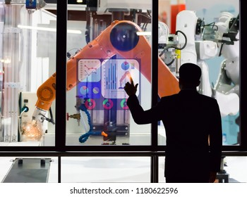 Engineer touch screen control the production of factory parts manufacturing industry robots and mechanical arm