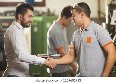 Engineer and Trainee Shaking Hands