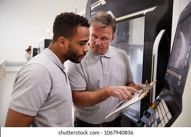 Engineer Training Male Apprentice To Use CNC Machine In Factory