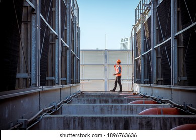 Engineer under checking the industry cooling tower air conditioner is water condenser cooling tower air chiller HVAC of large industrial building to control air system. - Shutterstock ID 1896763636
