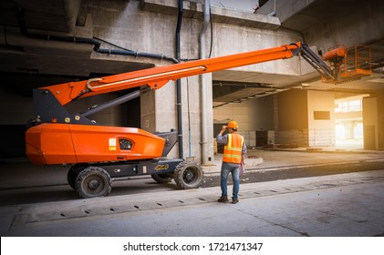 A engineer under inspection and checking construction process railway ,straight Boom Lift to construction roof on sky rail train by wearing safty uniform.