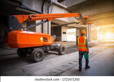 A engineer under inspection and checking construction process railway ,straight Boom Lift to construction roof on sky rail train by wearing safty uniform. - Shutterstock ID 1721471350
