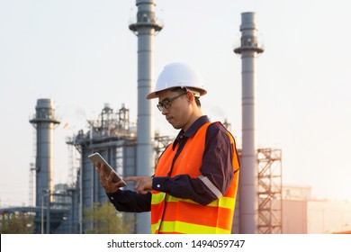 Engineer in uniform and helmet on of background the Construction Site power plant.