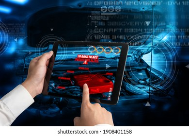 Engineer use augmented reality software to monitor parts of car vehicle with automated application . Futuristic machinery in working in concept of Industry 4.0 or 4th industrial revolution.