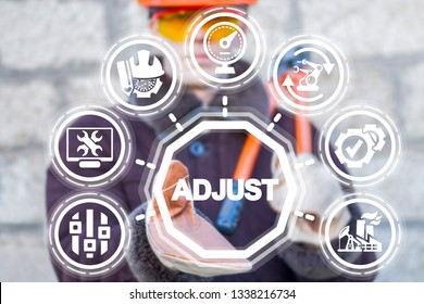 Engineer uses on a virtual screen of the future and sees the word: adjust. Adjustable industry concept. Adjustment editable manufacture.