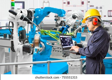 Engineer using laptop computer maintenance automatic robotic industry, Industry 4.0 concept