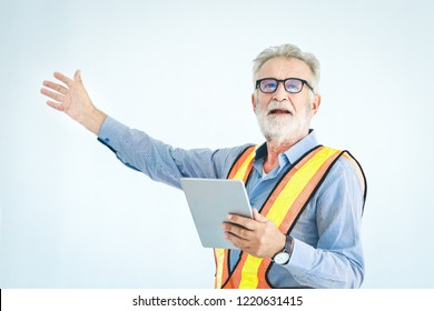 Engineer using laptop with safty helmet on white background, vintage style