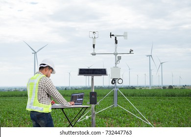 Engineer using tablet computer collect data with meteorological instrument to measure the wind speed, temperature and humidity and solar cell system on corn field, Smart agriculture technology concept