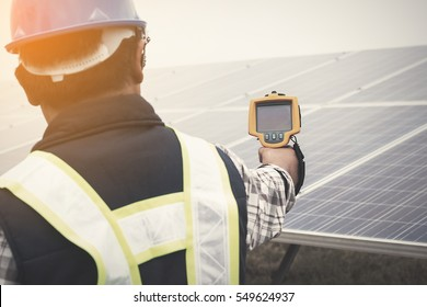 engineer using thermal imager to check temperature heat of solar panel