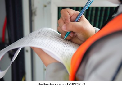 Engineer wear safety equipment write and record inspection report,worker write maintenance check list for preventive maintenance.