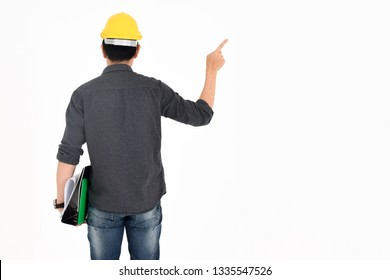 The engineer wear a yellow safty helmet has some files on his ha
