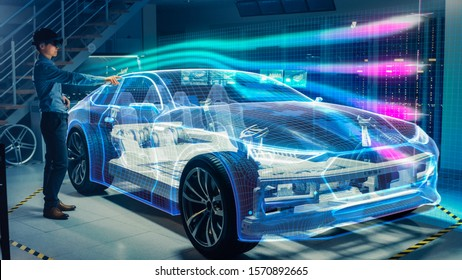 Engineer Wearing Augmented Reality Headset Working on New Electric Car Chassis Platform. 3D Graphics Visualization Virtual Model of a Vehicle is Tested in Digital Wind Tunnel.