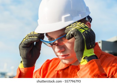 Engineer is wearing safety goggles.