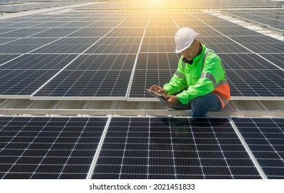Engineer wearing unifrom and helmet inspect and check solar cell panel ,solar cell is ecology energy sunlight power installation for industrail ,alternative environment power concept.
