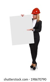 Engineer woman holding blank poster on a white background